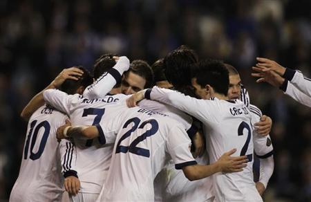 Real Madrid's players celebrate their goal against Deportivo Coruna during their Spanish First Division soccer match at the Riazor stadium in Coruna February 23, 2013. REUTERS/Miguel Vidal