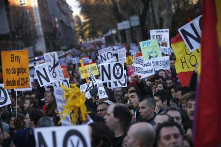 Demonstrators stage a protest against austerity, near the Spanish Parliament in Madrid February 23, 2013. Tens of thousands of Spaniards marched through cities across the country on Saturday to protest deep austerity, the privatisation of public services and political corruption. REUTERS/Juan Medina