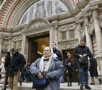 Members of the congregation leave Westminster Cathedral after hearing a mass for Pope Benedict in central London on February 24, 2013. On Sunday, Pope Benedict XVI, who will step down on Thursday, gave his last Angelus in St Peter's Square. REUTERS/Olivia Harris