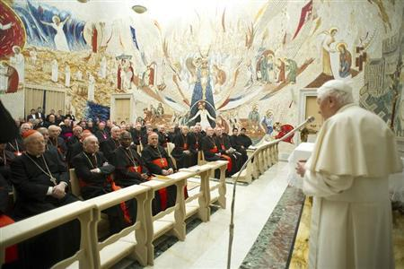 Pope Benedict XVI (R) speaks to Cardinals during the closing day of the Spiritual Exercises at the Vatican February 23, 2013. REUTERS/Osservatore Romano