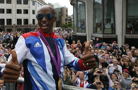 File photographg of athlete Mo Farah gestures as he takes part in a parade of British Olympic and Paralympic athletes through London September 10, 2012. REUTERS/Stefan Wermuth