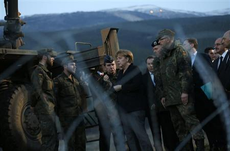 Germany's Chancellor Angela Merkel (C) meets with troops from a German NATO Patriot missile battery at a Turkish military base in Kahramanmaras February 24, 2013. REUTERS/Murad Sezer