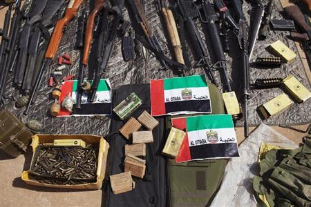 Munitions captured from Islamist rebels are seen on display for the press at the Malian airbase where French soldiers are stationed in Gao February 24, 2013. REUTERS/Joe Penney