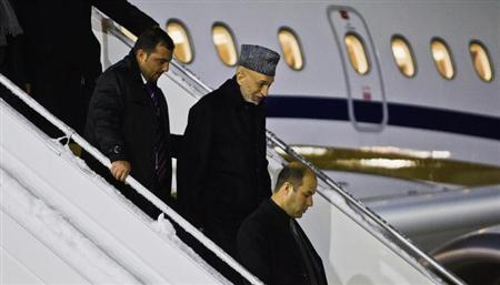 Afghanistan's President Hamid Karzai (2nd R) arrives at Gardermoen Airport in Oslo, in this picture provided by Scanpix February 4, 2013. REUTERS/Vegard Grott/NTB Scanpix