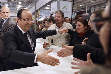 French President Francois Hollande (L) greets visitors at the 50th International Agricultural Show in Paris, February 23, 2013. REUTERS/Miguel Medina/Pool