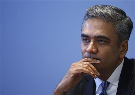 Anshu Jain, Co-Chairman of the Management board and the Group Executive Committee of Germany's largest business bank, Deutsche Bank AG listens during a visit at the Thomson Reuters office in Frankfurt February 21, 2013. Picture taken February 21, 2013. REUTERS/Lisi Niesner