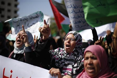 Palestinian women take part in a protest against the death of a Palestinian detainee in an Israeli jail, in Gaza City February 24, 2013. Palestinian officials on Saturday demanded an international investigation into the death of a Palestinian detainee who died in an Israeli jail hours earlier. A spokeswoman for Israel's Prison Authority said that the detainee, 30-year-old Arafat Jaradat, had apparently died of cardiac arrest. An emergency service team had tried to resuscitate him but failed, she said. REUTERS/Suhaib Salem