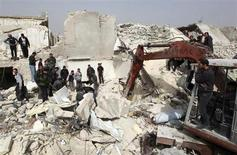 An excavator is used to search for casualties under the rubble at a site hit on Friday by what activists said was a Scud missile in Aleppo's Ard al-Hamra neighbourhood, February 23, 2013. REUTERS/Muzaffar Salman