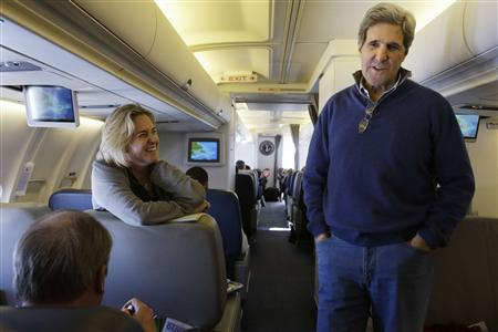 U.S. Secretary of State John Kerry speaks to media personnel aboard a plane that is en route to London on his inaugural official trip as Secretary, February 24, 2013. REUTERS/Jacquelyn Martin/Pool