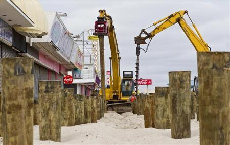 A construction crew puts pilings into the sand as the reconstruction of the boardwalk continues in Seaside Heights, New Jersey, February 22, 2013. REUTERS/Tom Mihalek