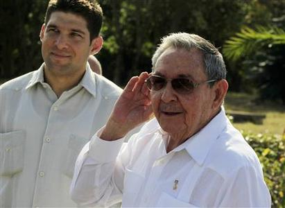 Cuba's President Raul Castro (R) gestures while talking to the media at the Soviet Soldier monument in Havana February 22, 2013. REUTERS/Enrique De La Osa