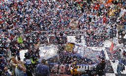Jimmie Johnson celebrates atop his number 48 Chevrolet after he won the NASCAR Sprint Cup Series Daytona 500 race at the Daytona International Speedway in Daytona Beach, Florida February 24, 2013. REUTERS/Joe Skipper