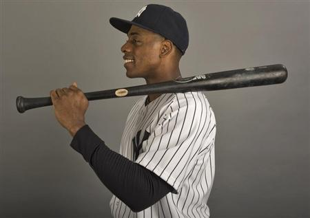 New York Yankees outfielder Curtis Granderson poses for a photograph during media photo day at the team's MLB spring training complex at George M. Steinbrenner Field in Tampa, Florida, February 20, 2013. REUTERS/Steve Nesius