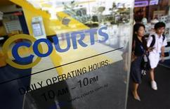 Shoppers leave the flagship Courts Megastore in Singapore, February 21, 2013. REUTERS/Edgar Su