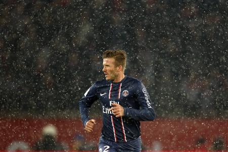 Paris Saint-Germain's David Beckham runs during their French Ligue 1 soccer match against Olympic Marseille at Parc des Princes stadium in Paris February 24, 2013. REUTERS/Charles Platiau