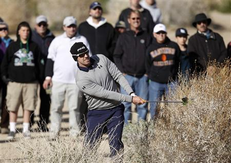 Hunter Mahan of the U.S. hits out of the bushes on the 17th hole during the championship match of the WGC-Accenture Match Play Championship golf tournament in Marana, Arizona February 24, 2013. Mahan lost to Matt Kuchar 2&1. REUTERS/Matt Sullivan