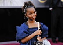 Quvenzhané Wallis, indicada ao Oscar de melhor atriz, chega ao tapete vermelho para a cerimônia do Oscar, em Los Angeles, neste domingo. 24/02/2013 REUTERS/Lucas Jackson