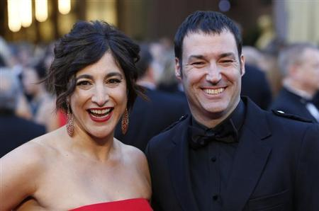 Director Mark Andrews and producer Katherine Sarafian of the film ''Brave'' arrive at the 85th Academy Awards in Hollywood, California February 24, 2013 REUTERS/Adrees Latif