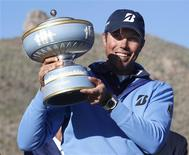 Matt Kuchar of the U.S. holds the trophy after beating Hunter Mahan 2&1 during the championship match of the WGC-Accenture Match Play Championship golf tournament in Marana, Arizona February 24, 2013. REUTERS/Matt Sullivan