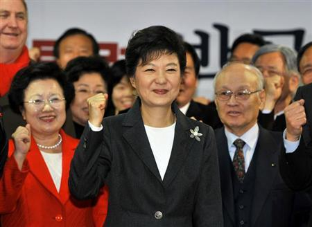 South Korea's president-elect Park Geun-Hye (C) from the ruling New Frontier Party, shouts her name with members of her election camp during a ceremony to disband the camp at the party headquarters in Seoul December 20, 2012. REUTERS/Jung Yeon-Je/Pool