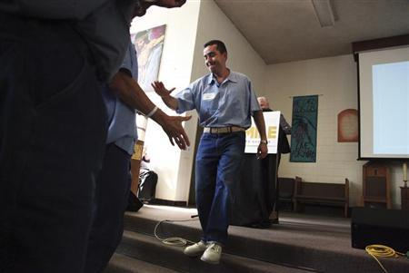 Jorge Heredia, an inmate at San Quentin State Prison, is congratulated by his fellow inmates after presenting his startup idea in San Quentin, California February 22, 2013. REUTERS/Gerry Shih
