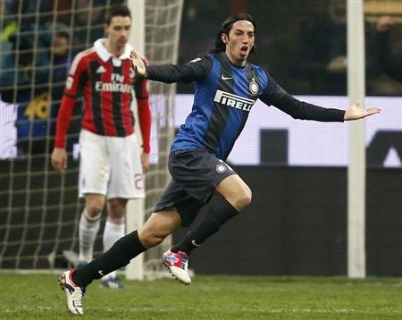 Inter Milan's Ezequiel Schelotto celebrates after scoring against AC Milan during their Italian Serie A soccer match at the San Siro Stadium in Milan February 24, 2013. REUTERS/Tony Gentile