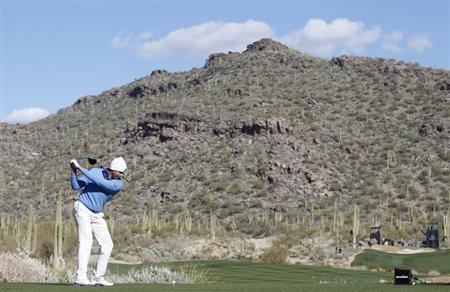 Matt Kuchar of the U.S. tees off on the 15th hole during the championship match of the WGC-Accenture Match Play Championship golf tournament in Marana, Arizona February 24, 2013. REUTERS/Matt Sullivan