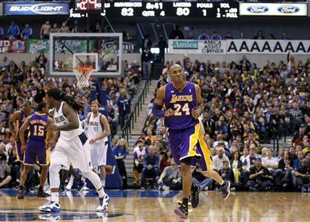 Los Angeles Lakers guard Kobe Bryant looks toward the Laker's bench after hitting a three-point shot against the Dallas Mavericks during the second half of their NBA basketball game in Dallas, Texas February 24, 2013. REUTERS/Mike Stone