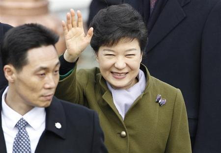South Korea's new President Park Geun-hye waves as she leaves after her inauguration at parliament in Seoul February 25, 2013.REUTERS/Lee Jae-Won