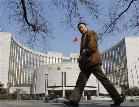 A man walks past the headquarters of the central bank of China in Beijing February 20, 2013. REUTERS/Kim Kyung-Hoon