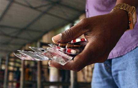 A patient holds free medicine provided by the government at Rajiv Gandhi Government General Hospital (RGGGH) in Chennai July 12, 2012. REUTERS/Babu/Files