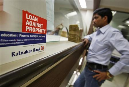 A customer waits to deposit money at a Ratnakar Bank branch in Mumbai, January 24, 2013. REUTERS/Vivek Prakash/Files