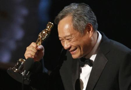 Director Ang Lee reacts after winning the Oscar for best director for 'Life of Pi' at the 85th Academy Awards in Hollywood, California, February 24, 2013. REUTERS/Mario Anzuoni