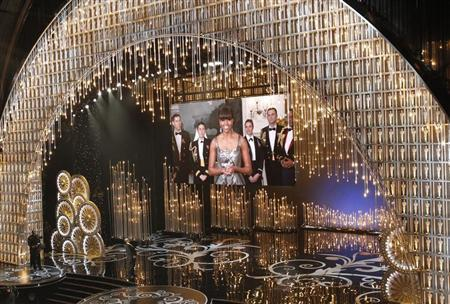 U.S. first lady Michelle Obama announces the winner of the best picture Oscar via video link at the 85th Academy Awards in Hollywood, California, February 24, 2013. REUTERS/Mario Anzuoni