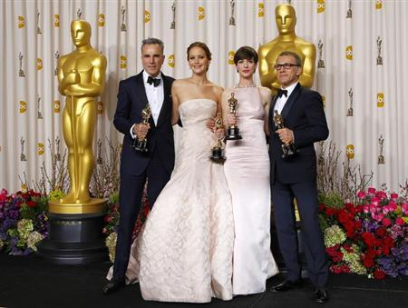 Daniel Day Lewis (L), best actor for ''Lincoln,'' Jennifer Lawrence, best actress for ''Silver Linings Playbook,'' Anne Hathaway, best supporting actress for ''Les Miserables and Christoph Walz, best supporting actor for ''Django Unchained'' pose with their Oscars backstage at the 85th Academy Awards in Hollywood, California February 24, 2013. REUTERS/Mike Blake