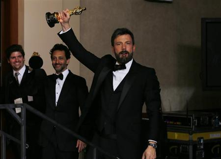 The producers of best picture winner ''Argo,'' Grant Heslov (2nd L) and Ben Afleck (R), hold up their awards backstage at the 85th Academy Awards in Hollywood, California, February 24, 2013. REUTERS/Mike Blake
