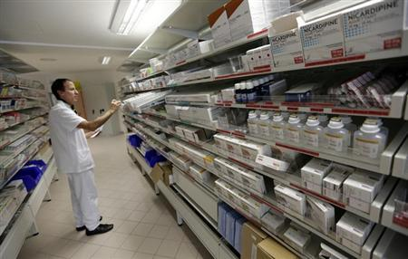 A pharmacist selects drugs for chemotherapy treatment in the pharmacy at Antoine-Lacassagne Cancer Centre in Nice October 18, 2012. REUTERS/Eric Gaillard/Files