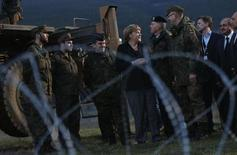 Germany's Chancellor Angela Merkel (C), meets with NATO German Patriot missile batteries' troops at a Turkish military base in Kahramanmaras February 24, 2013. The commander of German troops in Turkey Colonel Marcus Ellermann (in glasses) looks on third from right. REUTERS/Murad Sezer (TURKEY - Tags: POLITICS MILITARY)