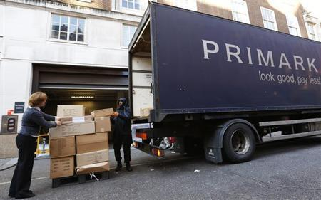 Stock is unloaded from a Primark lorry in central London November 5, 2012. REUTERS/Olivia Harris