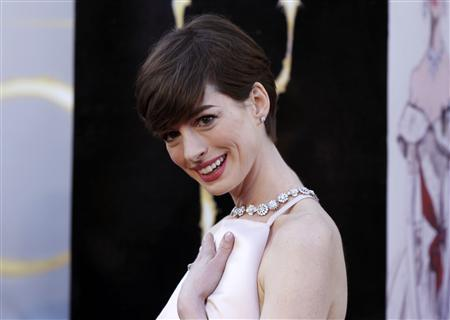 Anne Hathaway, best supporting actress nominee for her role in ''Les Miserables,'' arrives at the 85th Academy Awards in Hollywood, California, February 24, 2013. REUTERS/Lucas Jackson