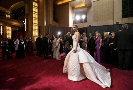 Jennifer Lawrence for ''Silver Linings Playbook'' wearing a white Dior Haute Couture arrives at the 85th Academy Awards in Hollywood, California February 24, 2013. REUTERS/Lucy Nicholson