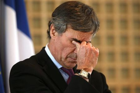 France's Junior Minister for Budget Jerome Cahuzac reacts as he attends a New Year wishes ceremony at the Economy Ministry in Paris January 23, 2013. REUTERS/Charles Platiau
