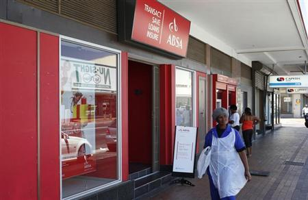 A woman walks past a branch of South Africa's biggest retail bank, Absa, in Cape Town, December 6, 2012. REUTERS/Mike Hutchings