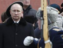 Russian President Vladimir Putin (L) attends a wreath laying ceremony to mark the Defender of the Fatherland Day in Moscow February 23, 2013. REUTERS/Maxim Shemetov