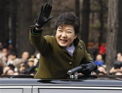 South Korea's new President Park Geun-hye leaves after her inauguration at the parliament in Seoul February 25, 2013. Park Geun-hye became the first female president of South Korea on Monday. She is the daughter of former military dictator Park Chung-hee who took power in a military coup in 1961 and ruled the country for 18 years. REUTERS/Kim Hong-Ji