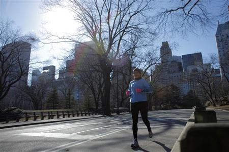 A woman jogs in Central Park in New York, January 24, 2013. REUTERS/Eduardo Munoz