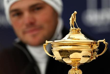 Germany's Martin Kaymer looks at the Ryder Cup during a news conference at the Dunhill Links Championship in the Old Course in St Andrews, Scotland October 3, 2012. REUTERS/David Moir