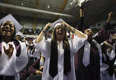 Students cheer as U.S. President Barack Obama attends the 2010 Kalamazoo Central High School graduation at Western Michigan University in Michigan, June 7, 2010. REUTERS/Larry Downing