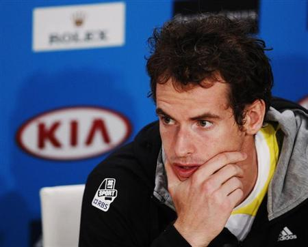 Andy Murray of Britain attends a news conference after being defeated by Novak Djokovic of Serbia in their men's singles final match at the Australian Open tennis tournament in Melbourne January 27, 2013. REUTERS/Daniel Munoz/Files