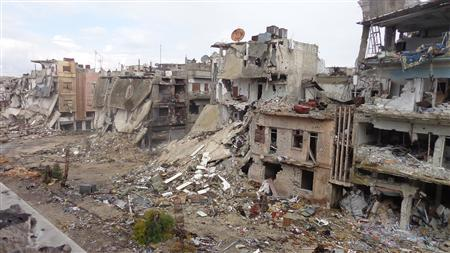 Destroyed buildings are seen on streets filled with debris in Homs, February 19, 2013, in this picture provided by the Shaam News Network. Picture taken February 19, 2013.